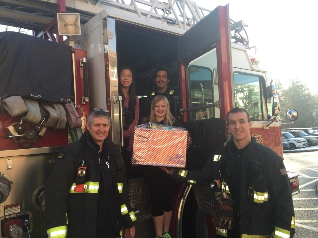 Helping those in need. Firefighters collect toys from our toy drive.