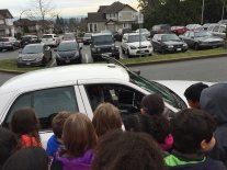 RCMP Sgt. Searle stops by to say hello and offer students a tour of his cruiser.