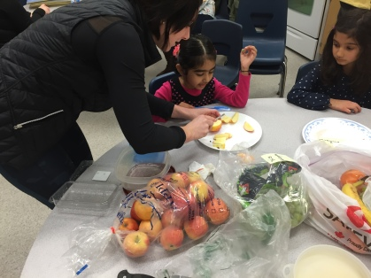 Another super mom helping to prepare a healthy lunch in Ms. Taank's class