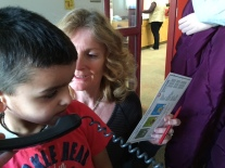 Kinder friend helps with morning announcements