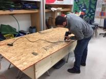 Mr. Stemler prepares ping-pong tables