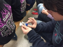 Preparing for high school - grade 7 students practice with combination locks