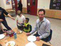 Mr. Nelson enjoys a slice of pizza.