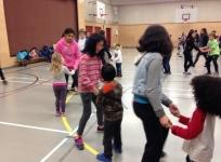 Gr.7 students teaching kindergarten friends how to polka.