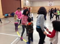 Gr.7 students teaching kindergarten friends how to polka.